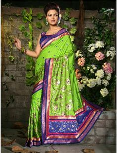 http://aiuchefashion.com/women-wear/saree/silk-sarees/94425229.html  This Season & Your Look Gets Better Definition With Just A Little Attention To Detail. Be Ready To Slip In The Comfort Zone Of Parrot Green Dupioni Raw Silk Saree. This Ravishing Attire Is Amazingly Embroidered With Floral Patch, Kasab, Multi & Resham Work.
