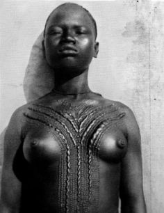 Africa | Woman from Chad. ca. 1925 | Image taken from the publication 'Decorated Skin- A world Survey of body art, Karl Groning Thames & Hudson.' pg 136