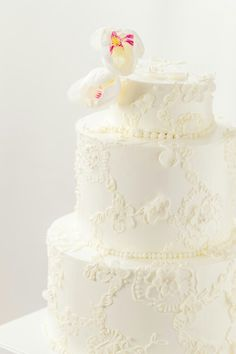 Meringue Bakery in La Crosse WI.  Buttercream lace cake made with piped frosting and small fondant accents.
