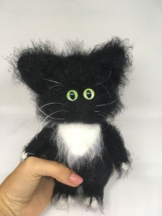 Our freestanding, amigurumi cat toy is made with fluffy yarn that is almost as soft as real fur. It could be customized in accordance with your oets pics.