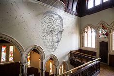 'For all time', an installation by  British artist Steven Follen - a 3D human face. Commissioned by The Royal Shakespeare Company, the installation is made up of 2000 hand-folded metal stars.