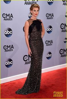 Faith Hill steps out onto the red carpet in style at the 2014 CMA Awards held at the Bridgestone Arena on Wednesday (November 5) in Nashville, Tenn.…