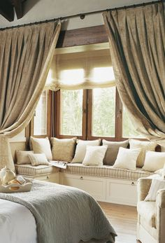 comfy window seat--- maybe something like this in the living room?