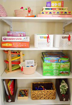 Who Needs Coats When You Can Have Toys? | Young House Love -- Toy library. One closet dedicated to toys that their 3 yr old has to 'check out' in order to play with. She can only 'check out' one type of toy at a time. They report that it has resulted in her cleaning up on her own before asking for another toy and also these toys hold her attention for longer periods.