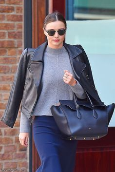 Miranda Kerr street style with Carven leather jacket and Celine handbag (March 2016). #mirandkerr