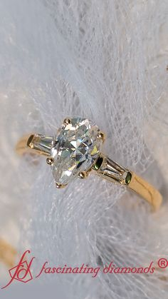 This baguette diamond ring is adorned with a pear shaped moissanite in the center, embellished with two tapered baguette diamonds on either sides of the center stone, the engagement ring is an absolute masterpiece. Stone Jewelry, Jewelry Rings, Jewelry Accessories, Jewlery, Baguette Diamond Rings, Baguette Ring, Leaf Engagement Ring, Gold And Silver Rings, Rings For Girls