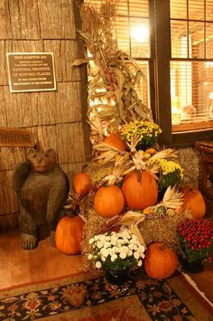 [Decoration] : Interior Design Exciting Design For Thanksgiving Decorations By Orange Pumkins Arranged On The Straws Feat Red And White Flowers On The Pot Combined With Area Rug And Bear Statue On The Laminated Wooden Floor