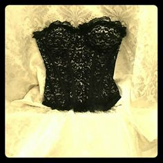 Lace corset Lace corset black on the outer layer and white on the inner. Padded at the breast area. Charlotte Russe Other