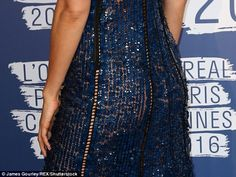 Oopsie! Irina saucily exposed her nude underwear and peachy derriere beneath the dress