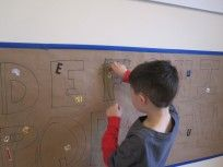 adding stickers to the alphabet wall mural