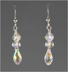This pair of exquisite earrings are made from aurora borealis Swarovski Crystal briolettes.  They are complimented with Swarovski Crystal accent beads also with the aurora borealis effect.