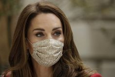Later, Kate opted to wear a face mask as she and Prince William visited the St. Bartholome...