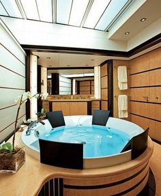 The master bath of the Harle, a 147-foot vessel from Sinot Yacht Design and De Voogt Naval Architects, boasts a circular soaking tub and skylights