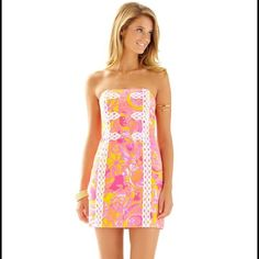 Lilly Pulitzer Tansy Strapless Sea and Be Seen So cute and amazing colors! This Tansy dress has lots of bright pinks and yellows, just beautiful! Lilly Pulitzer Dresses