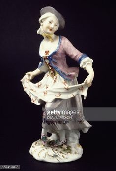 Young woman dancing, Meissen manufacture GERMANY - NOVEMBER 08: Young woman dancing, polychrome porcelain, height 18.4 cm, Meissen manufacture, Saxony. Germany, 18th century. Naples, Museo Nazionale Di Capodimonte (Art Gallery). (Photo by DeAgostini/Getty Images)