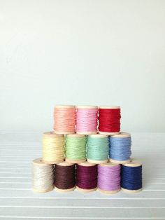Hand dyed twine on little mini spools Ten yards on each spool is enough to wrap 8-12 small packages. Or use several spools to crochet a colorful doily....