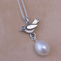 Items similar to Little Blackbird and Egg Pendant on Etsy Blackbird, Temple Jewellery, Precious Metals, Egg, Pearl Earrings, Jewels, Gemstones, Trending Outfits, Pendant