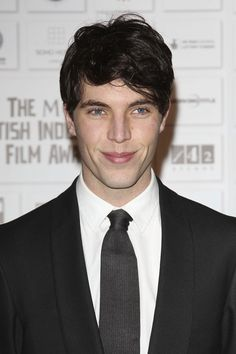 Tom Hughes Photos Photos - Tom Hughes on the red carpet at the Moet British Independent Film Awards at the Old Billingsgate Market, London. - Moet British Independent Film Awards