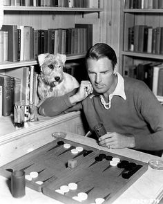 Randolph Scott and friend, at his backgammon board in his library