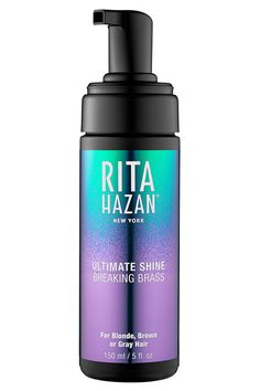 """it can definitely cut through our brassy tones — and even prevent brass. It'll make your locks extra shiny, too. """"You'll notice a difference after one or two washes,"""" celebrity hair colorist  Rita Hazan Ultimate Shine Gloss in Breaking Brass, $26, available at Sephora."""