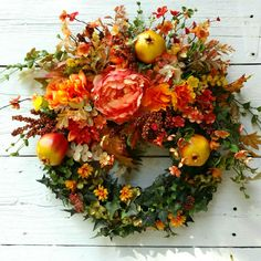 Lovely Pomegranates adorn  this scrumptious Autumn Wreath from 102 Design Studio