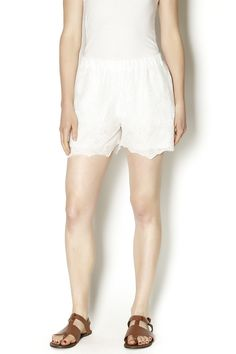 These shorts feature an intricate antique lace design in a subtle off-white, has elasticized waist for comfort and are perfect to rock on a hot day or as a beach cover-up!
