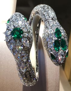 Double-headed Bulgari Serpenti one-of-a-kind bracelet watch with diamonds and emeralds.