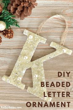 Learn how to make a beaded letter monogram ornament with this tutorial. Beaded letter ornaments are perfect for Christmas and weddings! Just start with any size wood letter. Easy step-by step tutorial with photos. Letter Ornaments, Diy Christmas Ornaments, Handmade Christmas, Creative Crafts, Diy And Crafts, Crafts For Kids, Christmas Craft Projects, Holiday Crafts, Modge Podge Projects