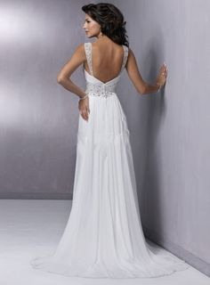 If we're planning a fantasy wedding, why not go for broke?  This is what the back of my dream dress would look like.