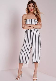 Jump into the season with a fresh new look. In white and black stripes with a bandeau neckline and culotte style, this 90's glam piece can be taken from day to night with just a footwear swap. Style with strappy heels and statement jeweller...