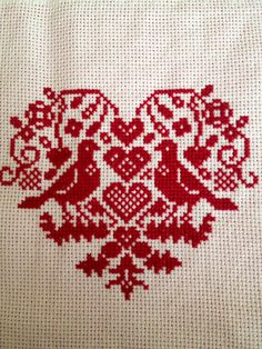 Heart cross stitch.
