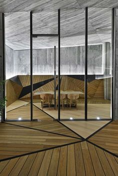 Differently stained Timber wood panelling laid in geometric fashion to create a stunning eye catching and very modern design.   Ator Ulus / Autoban