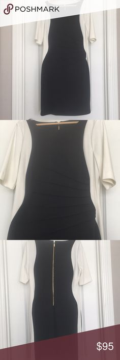 Ivanka Trump Dress, Beautiful & Flattering Ivanka Trump Dress, Starburt-style pleating for style, slimming effect, and great fit, worn once, in great used condition, slimming, stylish, great for work or a special occasion, classy & timeless  -Black & off-white in color  -gives a very slimming effect on the body Ivanka Trump Dresses Midi