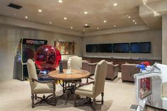 Game room with wall mounted tvs arcade games