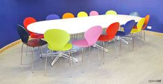 X large - giant meeting table with white star feet and ultramarine blue wall decor. #office #meeting #table