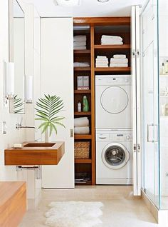 Laundry Room organization that is efficient! A smartly designed closet tucked away in a bathroom or hallway is the perfect solution. Stacking the washer and dryer leaves plenty of room for storage and eliminates the need for more square footage.