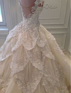 Ruffling glittering outstanding wedding dress.
