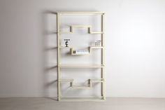 This rare and elegant neoclassical library shelf showcases all of the reasons why Pierre Vandel was so popular. Perfect proportions and high end construction elevates this white lacquered metal structure with brass detailing and bevelled glass shelves. This memorable and visually enticing design is the perfect piece for any contemporary home. Glass Shelves, Display Shelves, Shelving, Ladder Bookcase, Library Shelves, Mid-century Modern, Contemporary, American Modern, Metal Structure