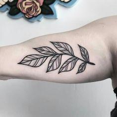 Inner arm tattoo leafs