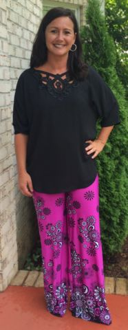 These fuchsia palazzo pants feature a flower print and flower border print along the bottom of the pants. These pants can be cut to the preferred length. No sewing needed!