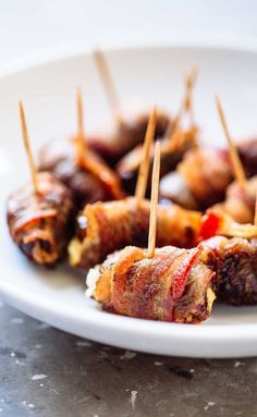 Bacon Wrapped Dates with Goat Cheese - a super easy 3-ingredient appetizer recipe that will blow you away!   pinchofyum.com