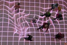 """APTOPIX Germany Art Installation People walk over the interactive installation """"Onskebronn"""", Norwegian for wishing well, at A central station in Berlin, Germany, Thursday, Oct. 14, 2010. The moving paths of visitors are followed on that LED-platform and retraced as reprocessed projections directly onto the floor. Sound is triggered by the movement of interacting visitors as they step onto the platform. The installation is created by German Sven Beyer of the performing arts group..."""
