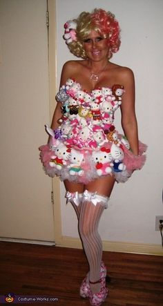 I am wearing this costume that I made. I pinned on the Hello Kitty dolls on a corset and two petty coats. It took me about a month, because I was constantly re-arranging the dolls to get the dress right. I bought cupcake toppers for the shoes. I cut the ring part off of each cupcake topper and glued them to the shoes. I made a hello kitty doll as a hair clip too.  This was inspired from Lady Gaga's photo-shoot for Hello Kitty.