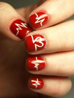 Valentine's Day Nail Art -- EKG Nails: Hint that that your heart goes pitter-patter when your true love is near with this Valentine's Day nail art design that mimics the lines of an EKG. The Nailasaurus created the inventive look using a true red base color and white acrylic paint applied with a thin brush. February is Heart Health month (in Canada).