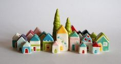 love these little ceramic homes - as seen on 1000 Homes of Happiness