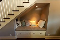 That small space under the stairs can be used to create the perfect reading nook without getting in the way.
