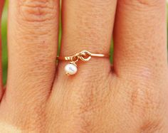 Pearl gold ring, 14k gold filled ring, delicate thin engagement ring, weeding, stacking ring, charm hammered ring. $25.00, via Etsy.