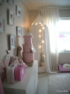 Shabby Chic Little girl's room...love the fairy lights!