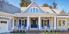 There's alot to see beyond that pretty porch. | Inside a Beautiful Lowcountry Home That Isn't Afraid to Embrace Bold Colors