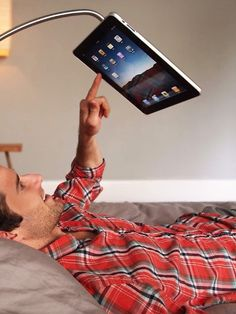 This is what I've been looking for! I've woken myself up when I fall asleep & drop my iPad on my face!